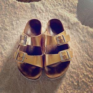 Women's Birkenstock's metallic gold Arizona sandal